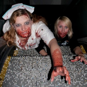Zombies crawling up escalator